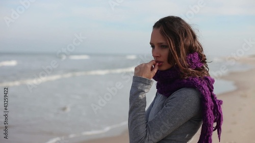 Beautiful girl deep in thought on beach