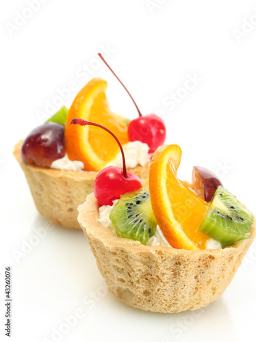 sweet cakes with fruits isolated on white