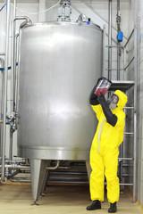 technician examining sample - industrial process control
