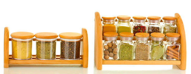 jars with spices on wooden shelfs isolated on white