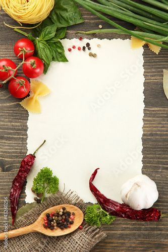 Fotobehang Kruiden 2 paper for recipes vegetables, and spices on wooden table
