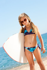Cute gril ready to go surfing.