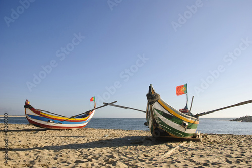 Typical portuguese fishing boat on the beach, Espinho, Portugal - 43260800