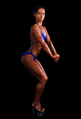 Muscular woman posing on black background