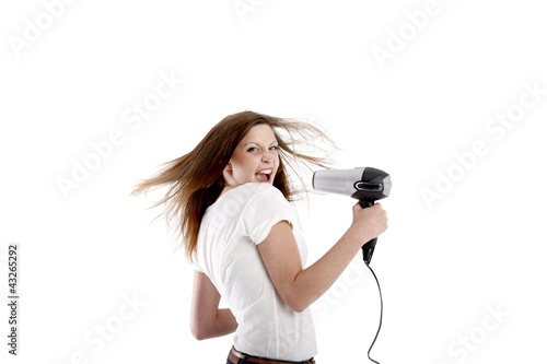 canvas print picture young beauty with hairdryer (white background)