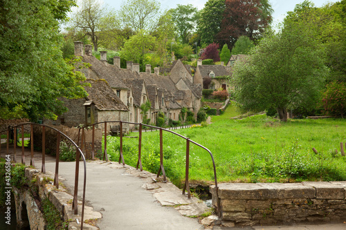 Bibury. Traditional Cotswold cottages in England, UK. spring.
