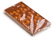 Chocolate with nuts wrapped in transparent foil.