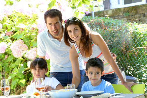Closeup of happy family having lunch in garden