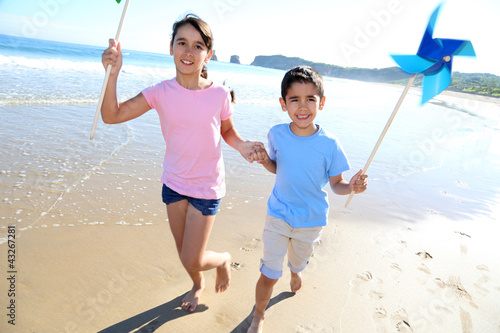 Kids running on the beach with swirls