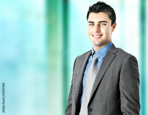 Handsome smiling businessman