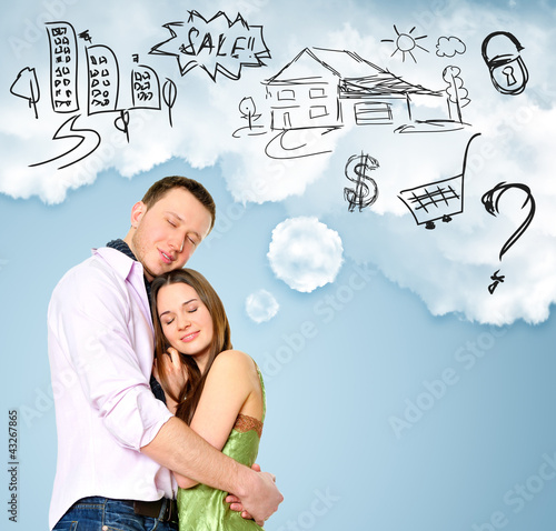 Smiling beautiful couple standing and embracing. Woman dreaming
