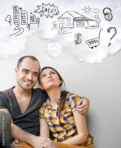 Closeup portrait of adult couple sitting on floor at their apart