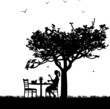Silhouette of smoking woman with cup of coffee in garden