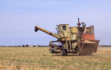 Combine harvesting a wheat field