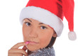 Close up of female in Santa Claus hat over a white background.