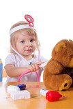 Little girl playing as doctor with stethoscope