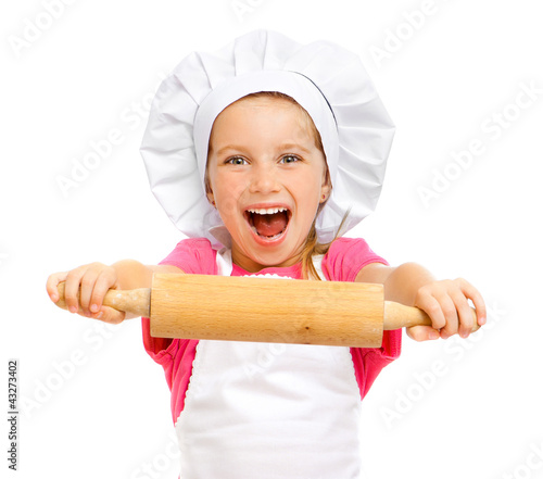 beautiful little girl with a rolling pin