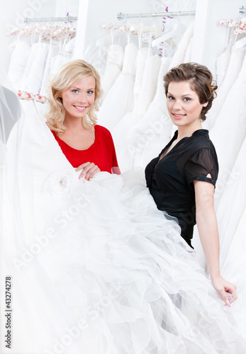 Bride is ready to try this wedding gown on, white background
