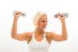 Fitness woman lifting weights looking biceps