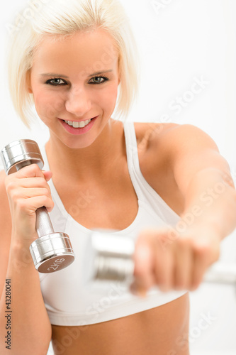 Excited fitness woman workout with weights