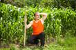 Young farmer near a corn field