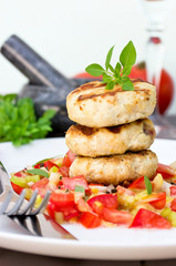 Delicious grilled burgers with vegetable salad for dinner