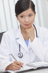 Chinese Female Woman Hospital Doctor Writing In Office