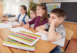 Schoolchildren at classroom during a lesson poster