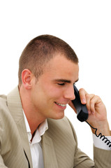 Young manager speaking by phone in office