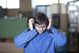 Blue collar worker at noisy workplace