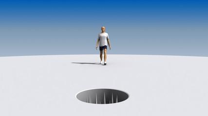 Man walks toward an open hole full of spikes.