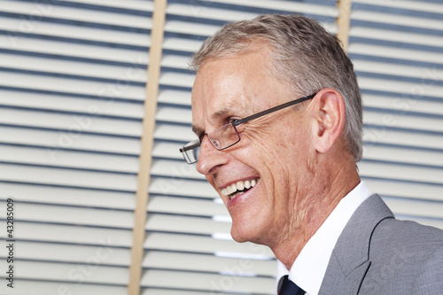 experienced businessman smiling