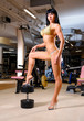 Athletic beautiful woman posing in the fitness club