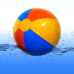 Colorful beach ball floating in water
