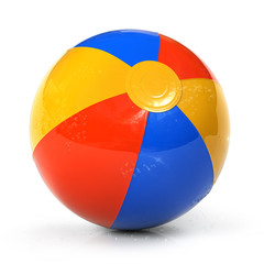 Colorful beach ball with water drops
