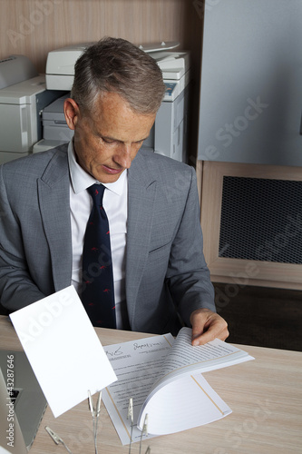 businessman  reads the contract