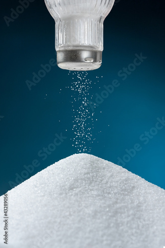 Pouring salt from a salt pot - 43289056