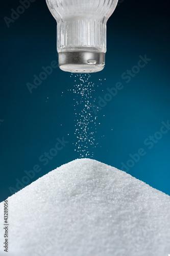 Pouring salt from a salt pot