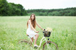 Woman on bicycle in field