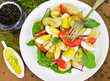 Vegetable salad with grilled potatoes
