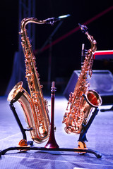 Two saxophones on stage