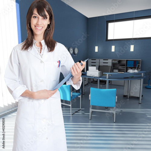Young woman wearing a  lab coat in an office