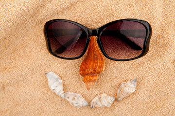 Shellfishes and sunglasses representing a face
