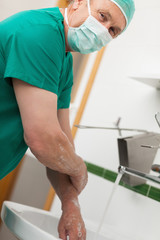 Surgeon washing hands with soap