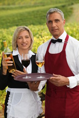 waiter and waitress serving wine