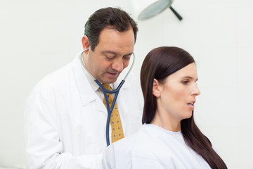 Patient being auscultated by a doctor