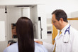 Doctor conducting a mammography on a patient