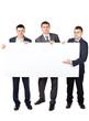 Three young businessmen hold up a large blank sign isolated