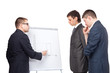 Three young  business men and a flipchart isolated on white back