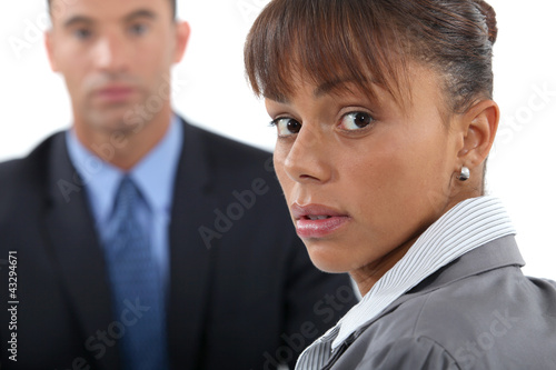 Concerned businesswoman and colleague